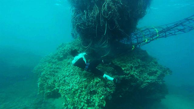 hunting for 11ton fishing net in the war against ocean trash