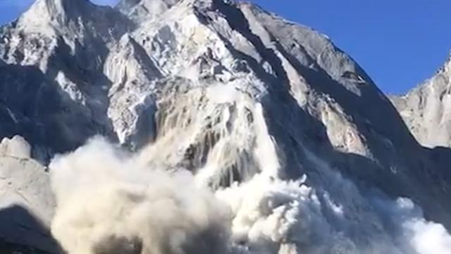 Watch a massive avalanche and mudslide sweep down a mountain for Mountain watches